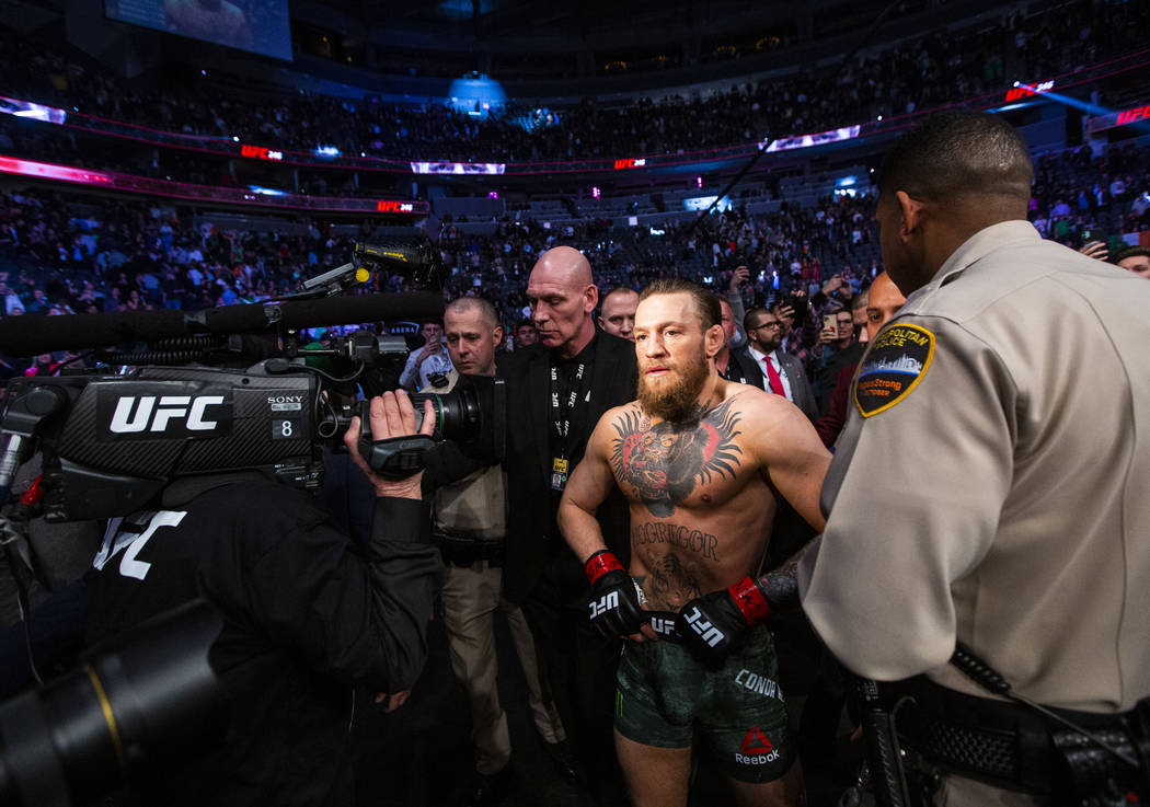 "Conor McGregor leaves the octagon after defeating Donald ""Cowboy"" Cerrone via technic ..."