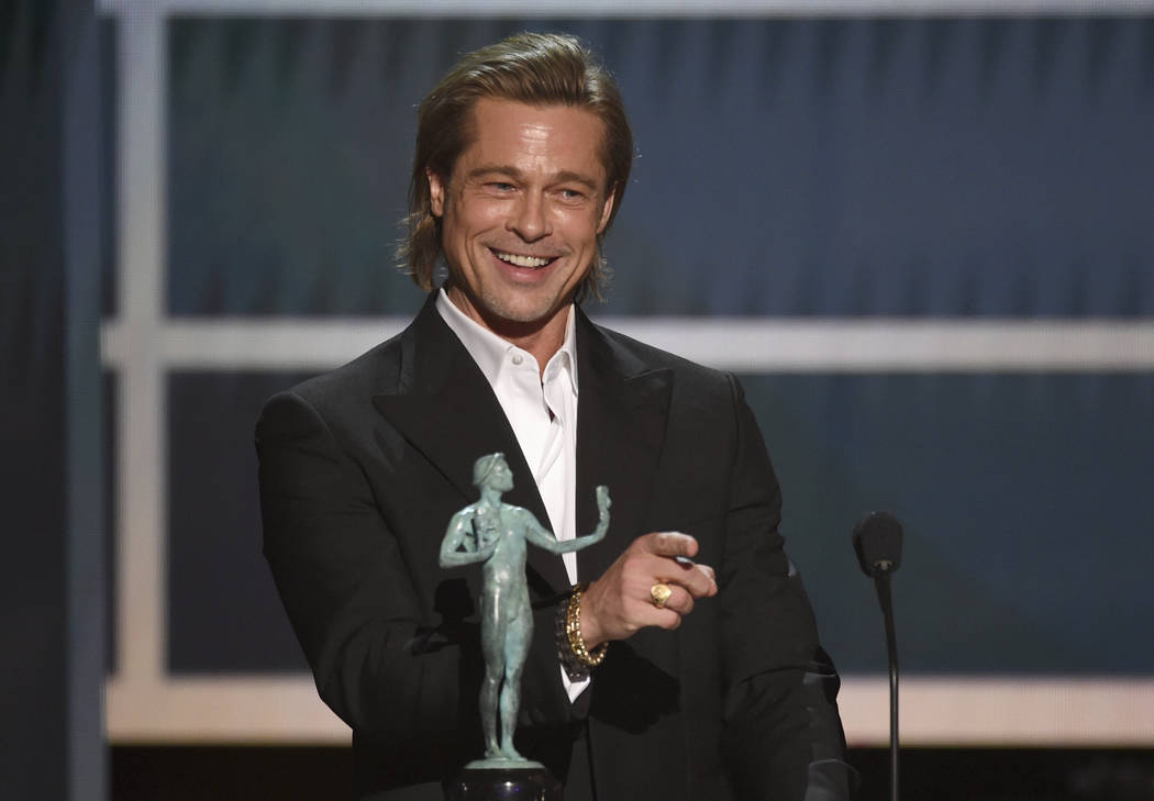Brad Pitt accepts the award for outstanding performance by a male actor in a supporting role fo ...