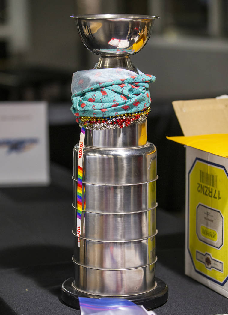 The winners trophy sits on the check-in table during the Sin City Classic hockey tournament at ...