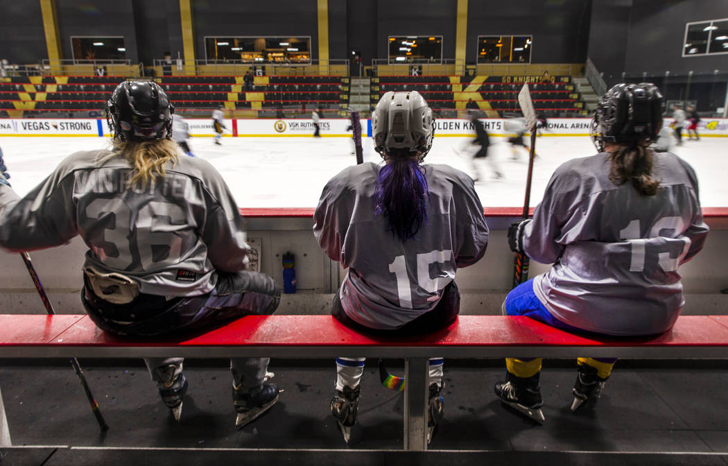 Team Flamingos players watch the action from the bench against the Blackjacks in their semi-fin ...