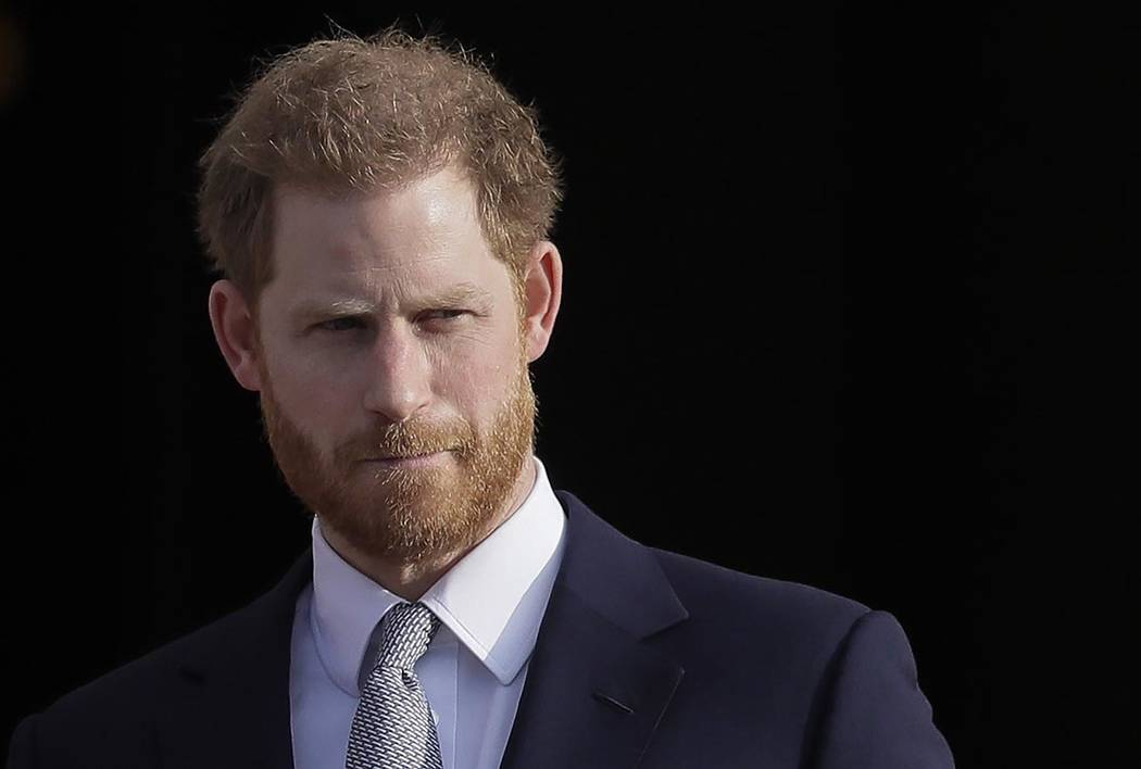 In a Thursday, Jan. 16, 2020, file photo, Britain's Prince Harry arrives in the gardens of Buck ...