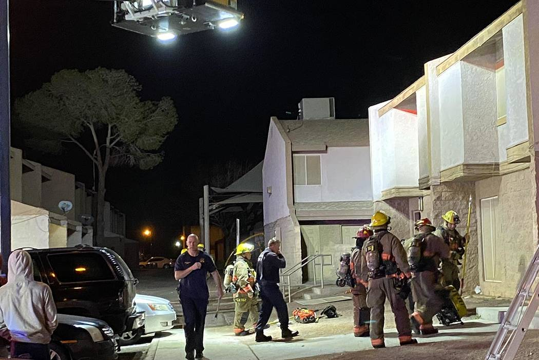 North Las Vegas and Clark County firefighters at the scene of an apartment fire at 4980 E. Owen ...