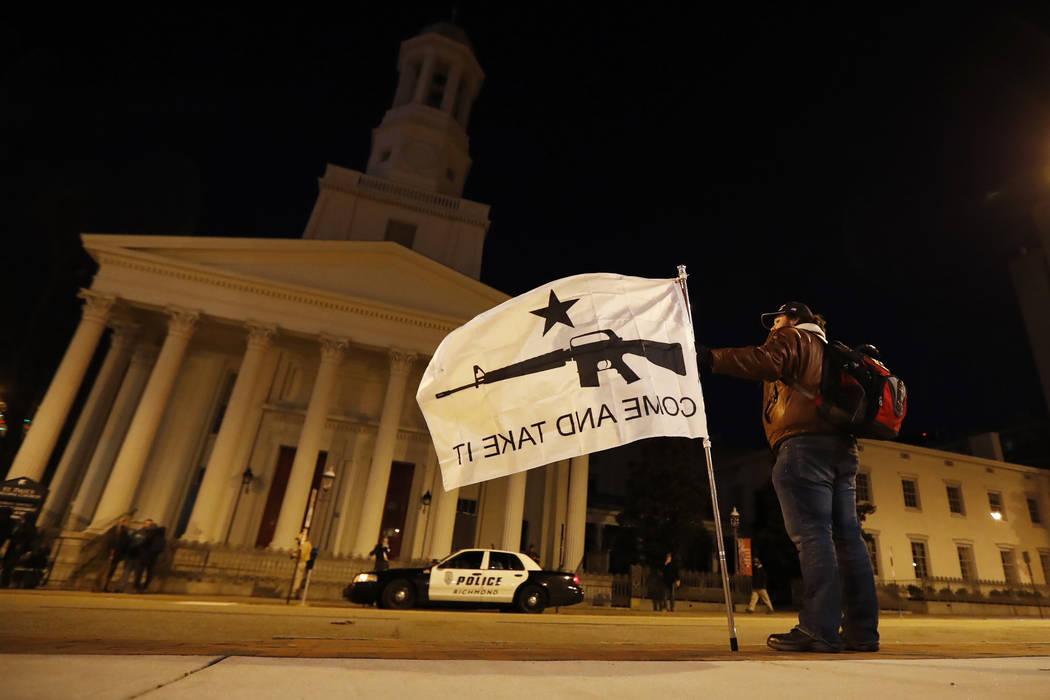 Kem Regik, of Virginia, stands on the sidewalk before a pro gun rally, Monday, Jan. 20, 2020, i ...