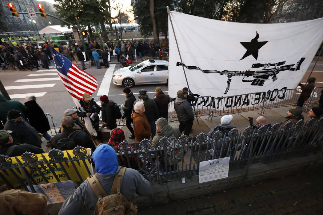 People line up outside the capitol before a pro gun rally, Monday, Jan. 20, 2020, in Richmond, ...