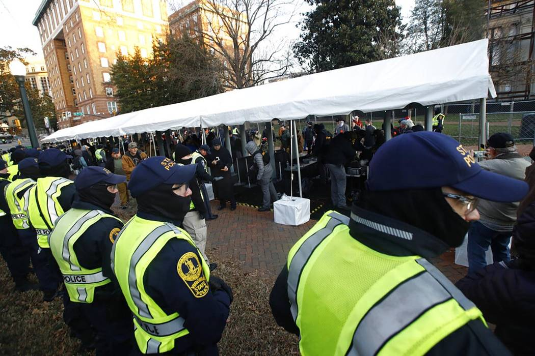 Virginia State police troopers stand near a security checkpoint before demonstrators enter the ...