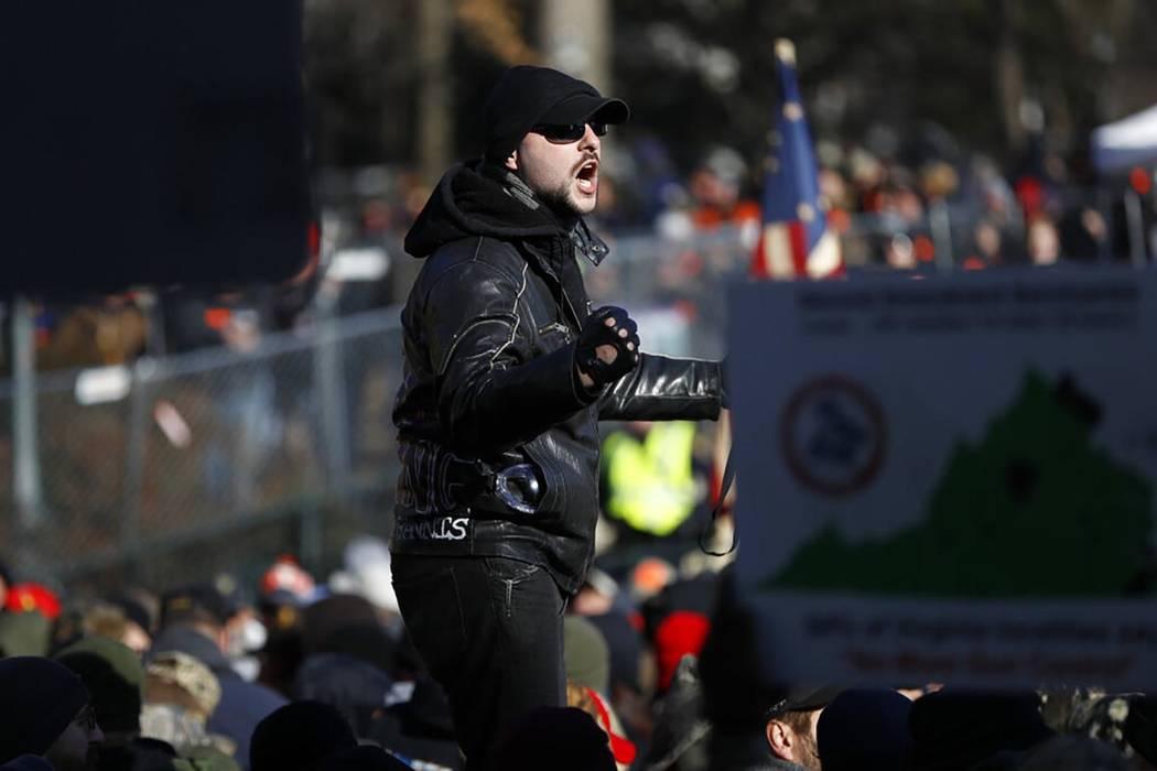 A man speaks during a pro-gun rally, Monday, Jan. 20, 2020, in Richmond, Va. Thousands of pro-g ...