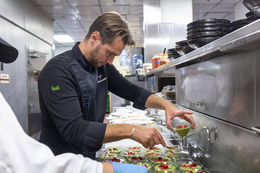 Chef Yuri Szarzewski of EATT Groumet Bistro prepares the chilled sweet pea, spinach and mint so ...