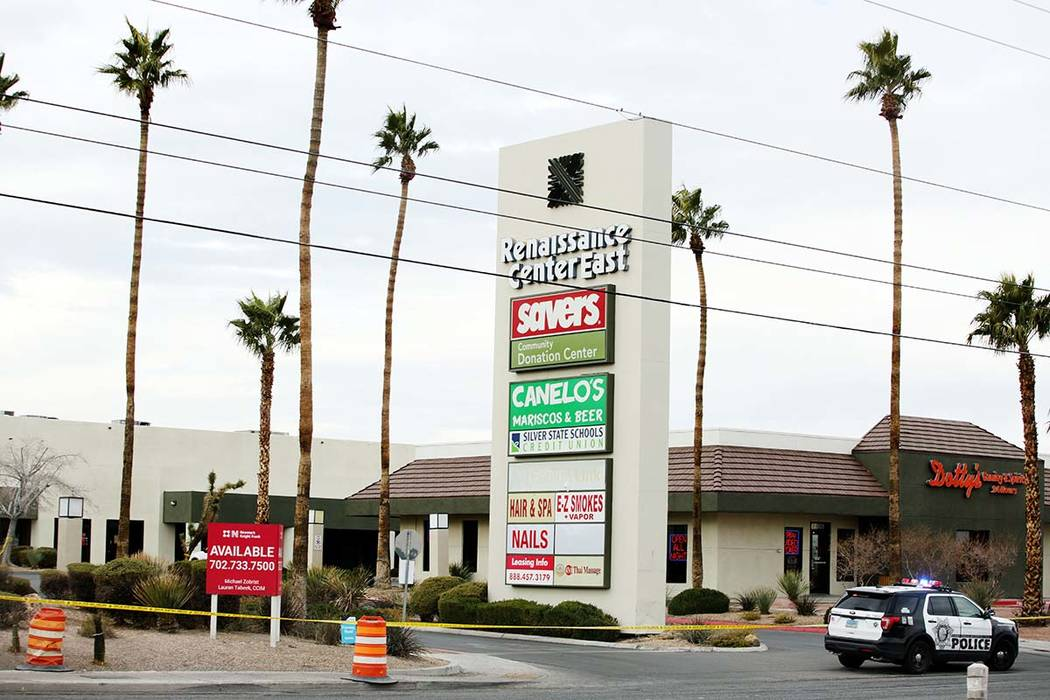 Police tape closes off the the Renaissance Center East shopping complex in Las Vegas on Monday, ...
