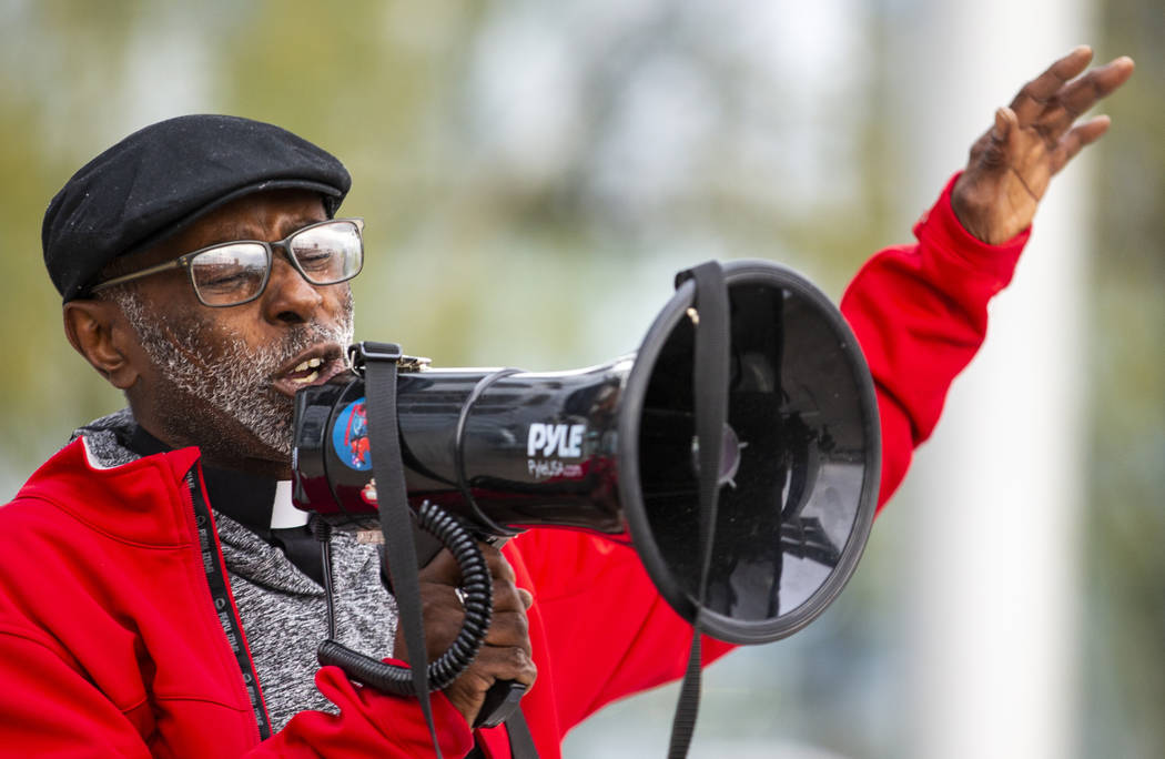 The Rev. Harold Washington-Carnes speaks as local activists rally at the Las Vegas City Hall th ...