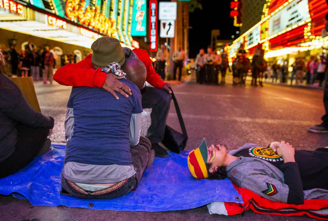 The Rev. Harold Washington-Carnes hugs another local activist as she helps blocks Casino Center ...