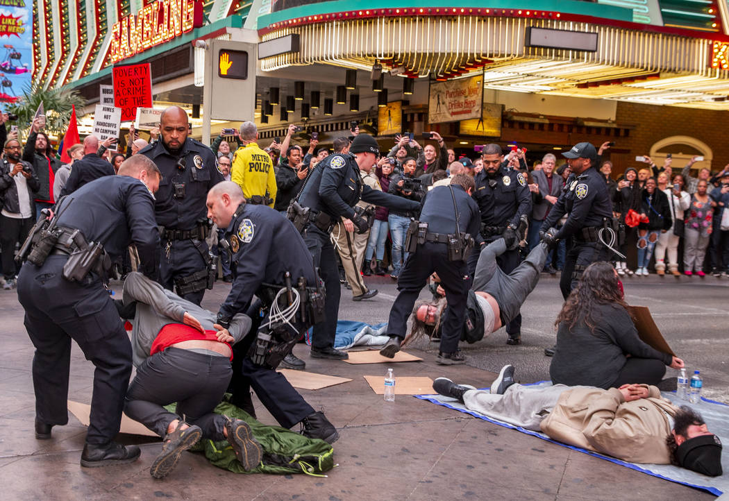 Las Vegas Metropolitan Police officers arrest local activists blocking Casino Center Blvd. thro ...
