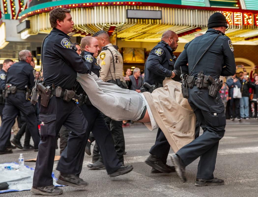 Las Vegas Metropolitan Police officers arrest local activist Joey Lankowski for blocking Casino ...