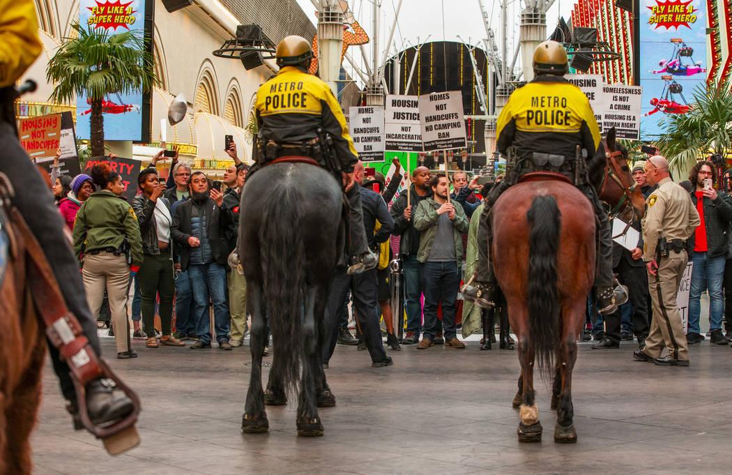 Las Vegas Metropolitan Police officers keep local activists back after blocking Casino Center B ...
