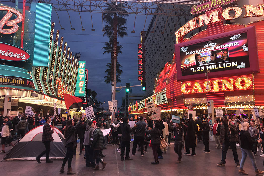 Activists gathered Monday, Jan. 20, 2020, in downtown Las Vegas to protest the two controversia ...