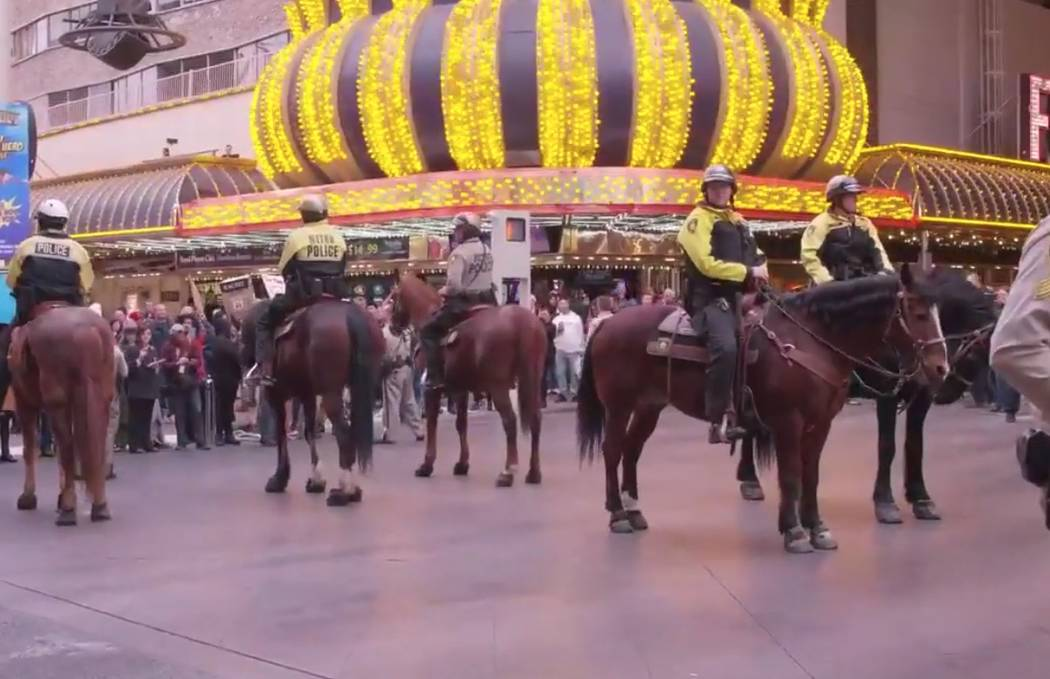 Las Vegas police stand guard Monday, Jan. 20, 2020, in downtown Las Vegas. Activists gathered o ...