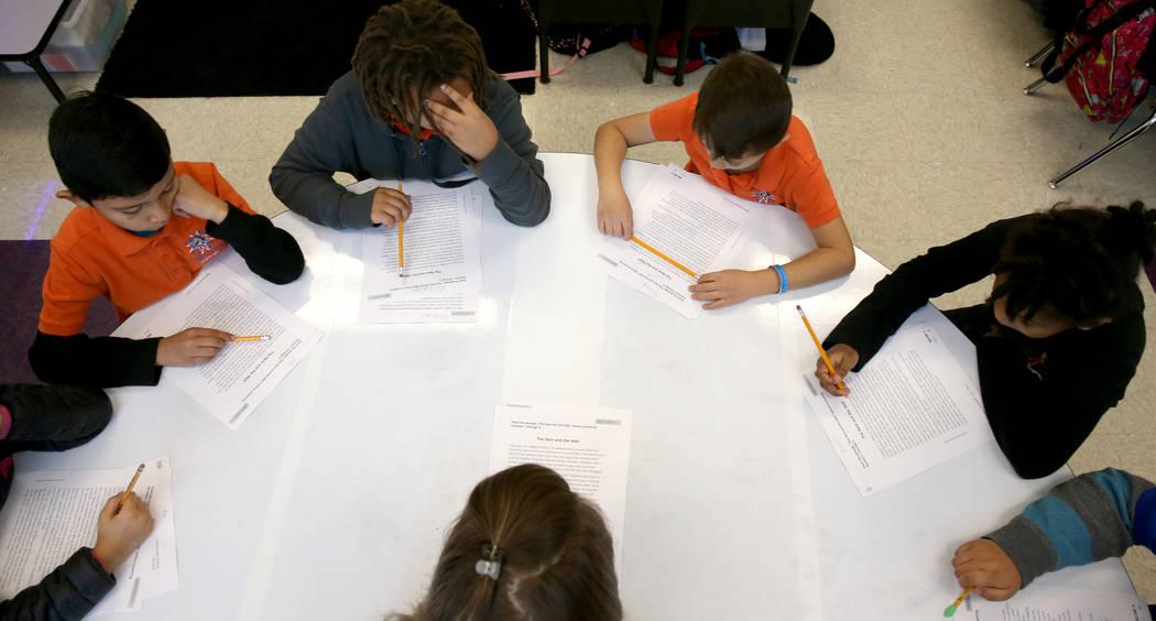 Third grade teacher Laura Ernst works with students at Mater Academy Mountain Vista charter sch ...