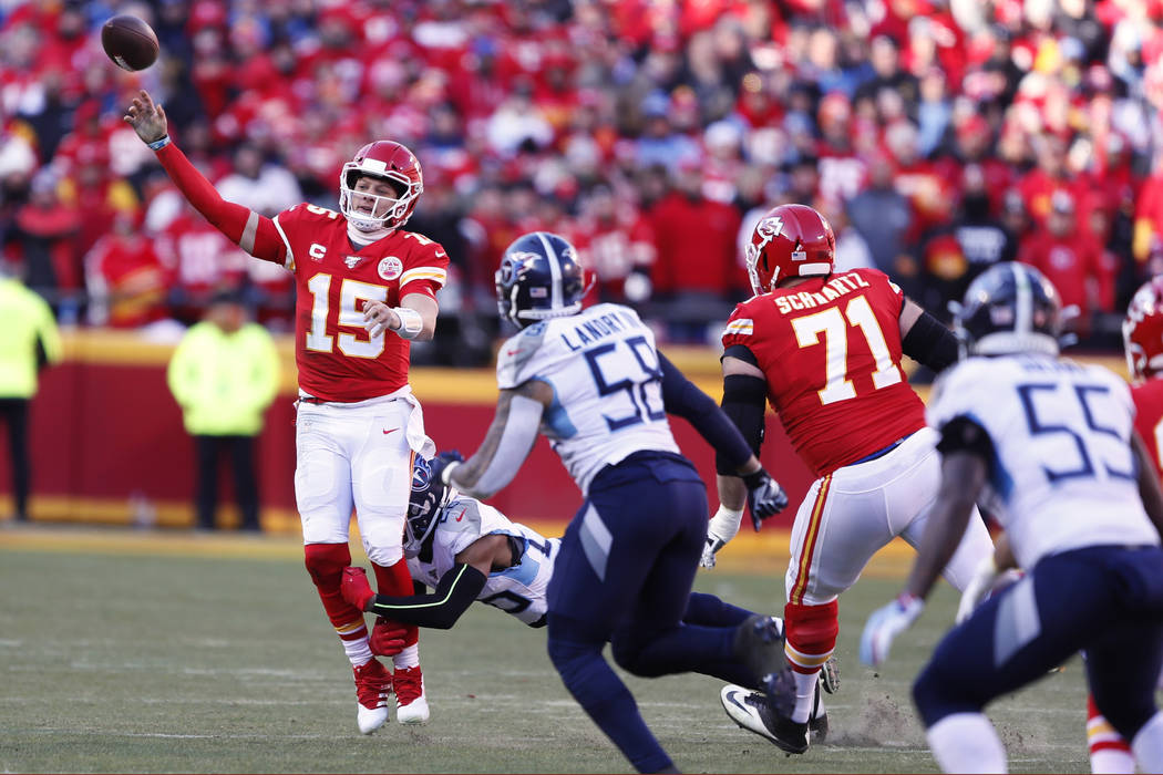 Kansas City Chiefs' Patrick Mahomes throws under pressure during the first half of the NFL AFC ...