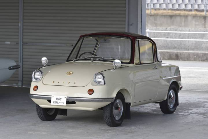 Mazda Mazda has come a long way in the past 100 years. Shown here is one of the earliest models ...