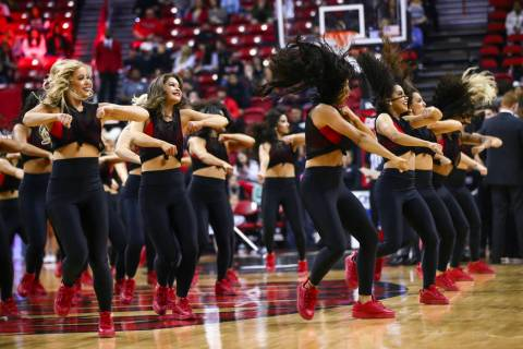 The Rebel Girls perform during the first half of a basketball game at the Thomas & Mack Cen ...