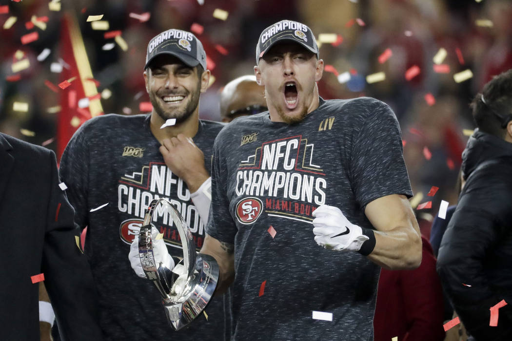 San Francisco 49ers tight end George Kittle, right, and quarterback Jimmy Garoppolo celebrate a ...