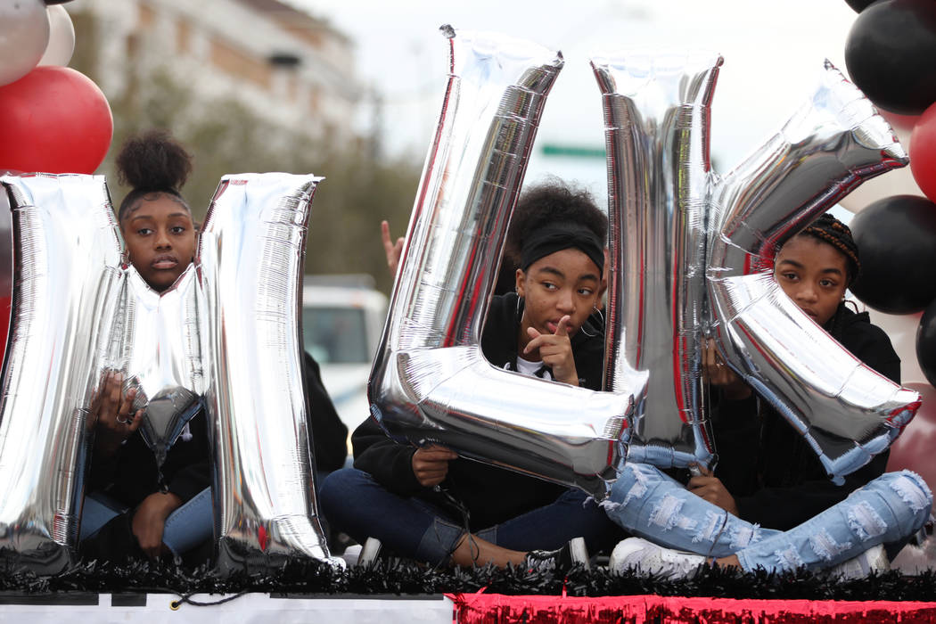A float with MLK initials is seen during the 38th annual Dr. Martin Luther King Jr. Parade in d ...