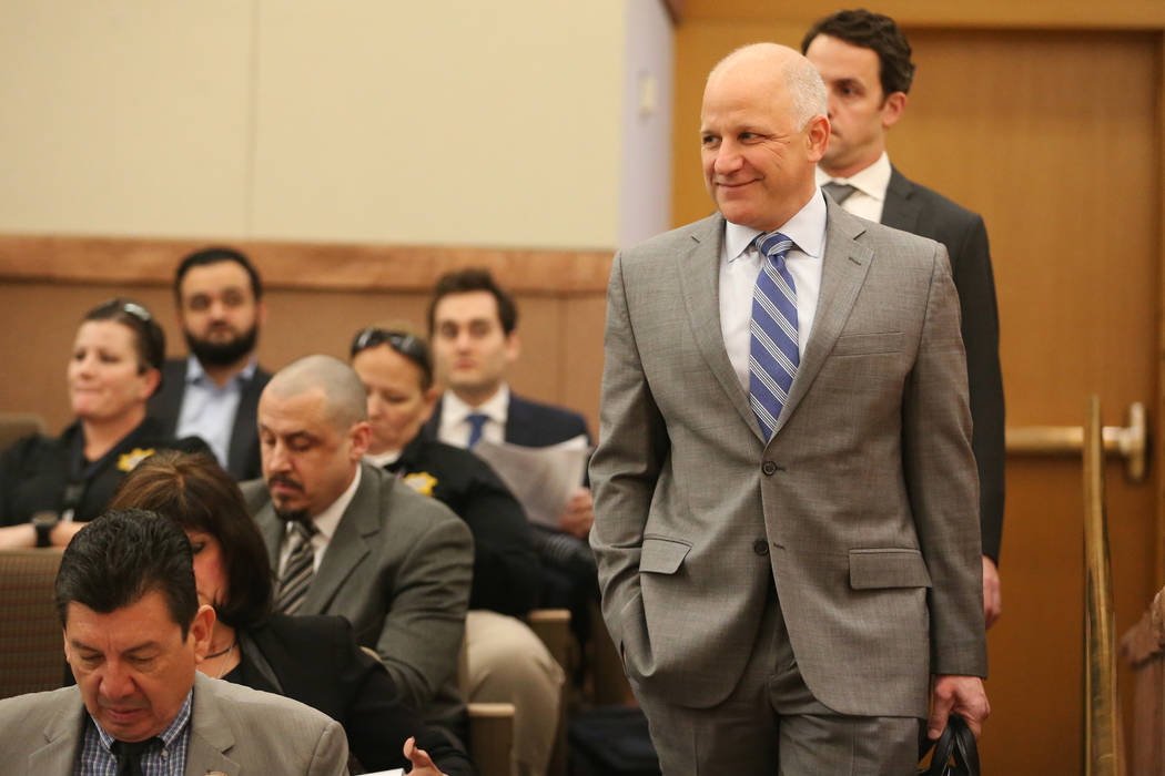 Raiders President Marc Badain attends at the Clark County Commission meeting for the presentati ...
