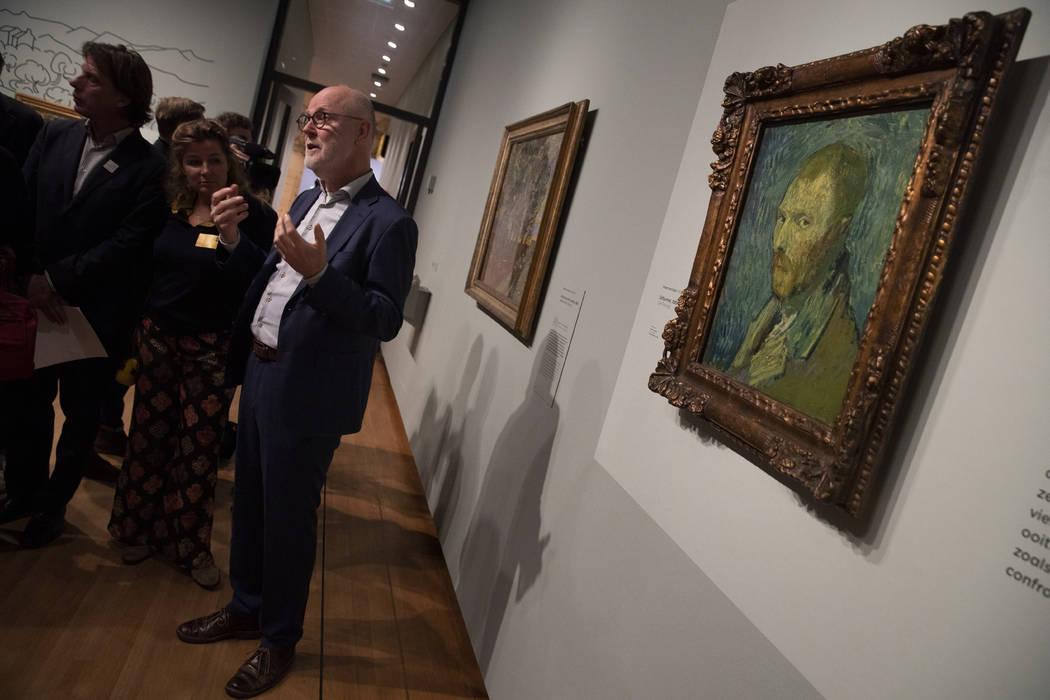 Van Gogh Museum's senior researcher Louis van Tilborgh gestures as he talks to journalists abou ...