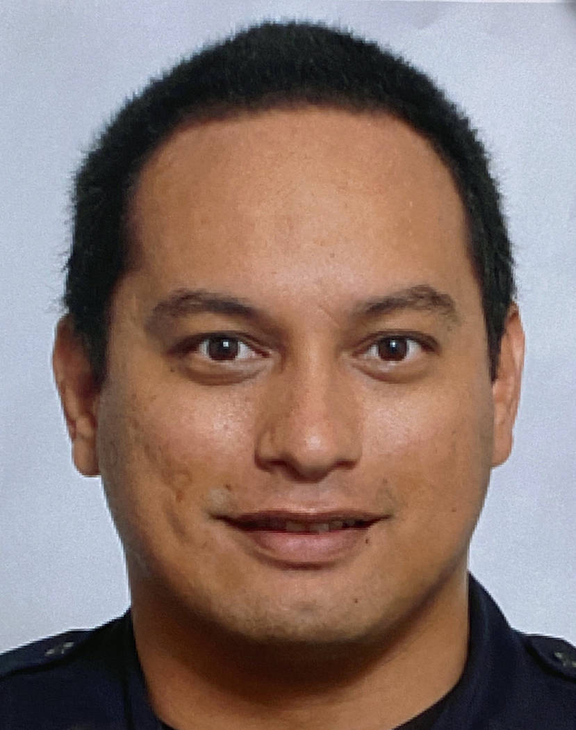 This undated photo provided by the Honolulu Police Department shows Officer Kaulike Kalama. Kal ...