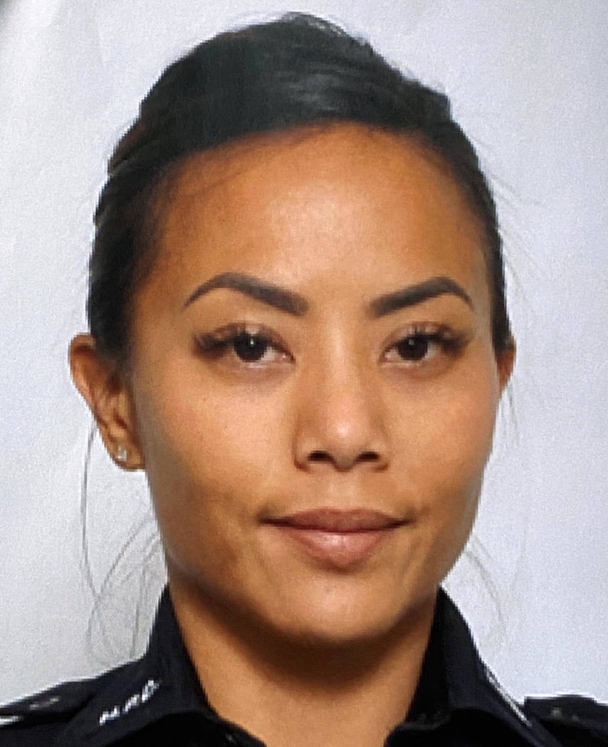 This undated photo provided by the Honolulu Police Department shows Officer Tiffany Enriquez. E ...