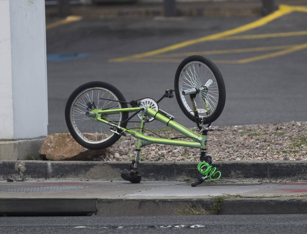 The bike of the 12-year-old boy that was struck by a car and seriously injured while riding on ...