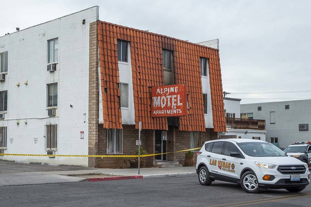 A Las Vegas Fire & Rescue vehicle arrives in the street outside of the Alpine Apartment Mot ...