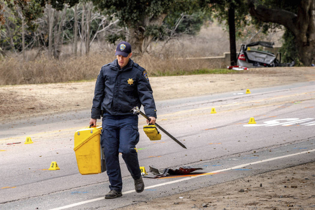 An officer with the California Highway Patrol's (CHP) Multidisciplinary Accident Investigation ...