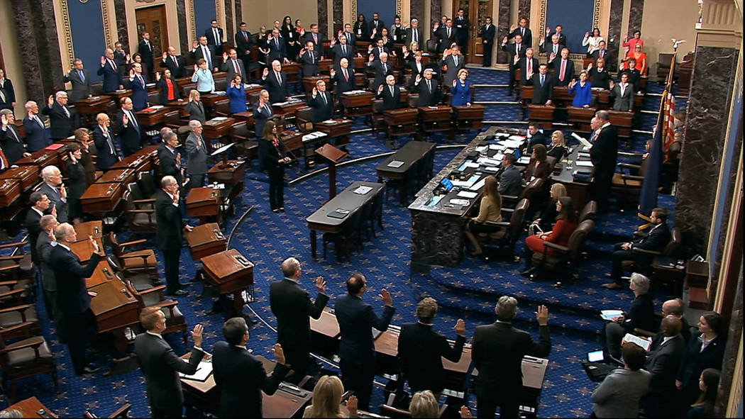 Presiding officer Supreme Court Chief Justice John Roberts swears in members of the Senate for ...