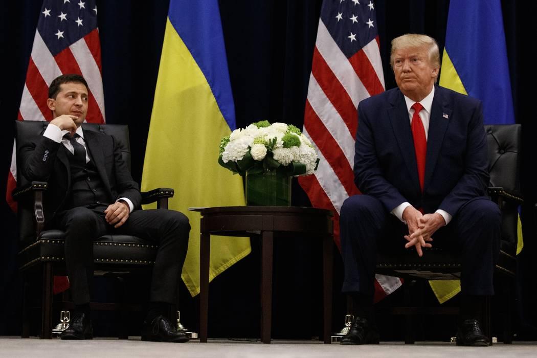 President Donald Trump meets with Ukrainian President Volodymyr Zelenskiy, left, at the InterCo ...