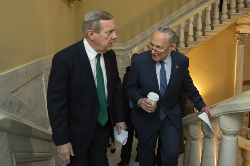 Democratic leader Sen. Chuck Schumer, D-N.Y., right, and Sen. Dick Durbin, D-Ill., walk on the ...