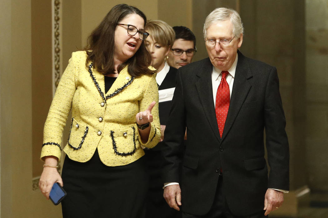 Senate majority leader, Sen. Mitch McConnell, R-Ky., right, walks back to the Senate chamber at ...