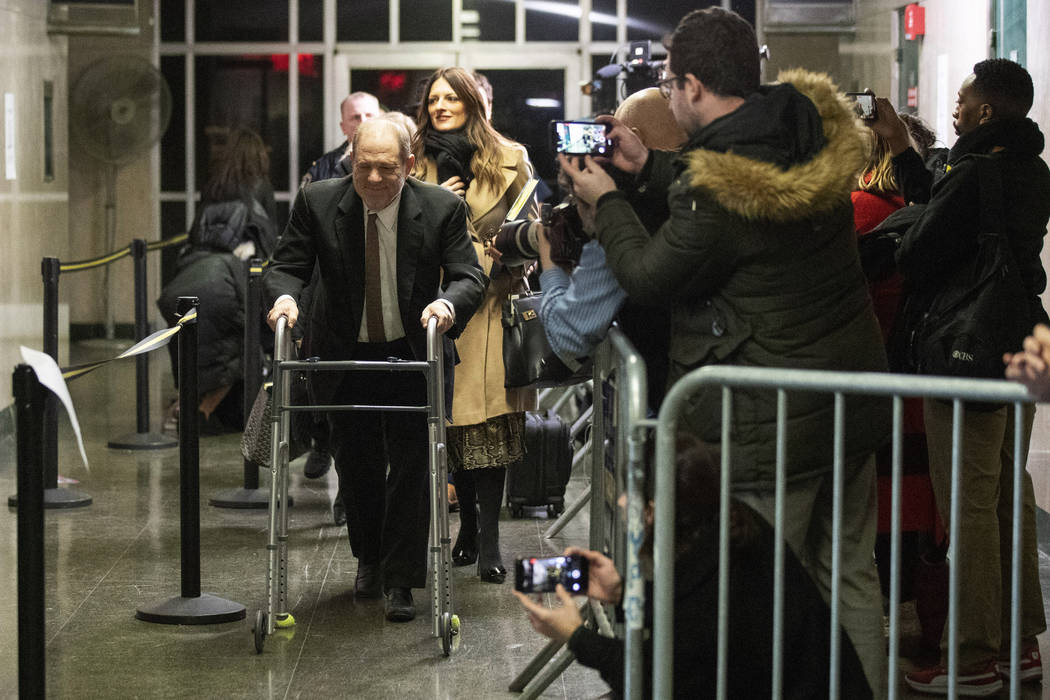 FILE - In this Tuesday, Jan. 14, 2020, file photo, Harvey Weinstein, left, leaves court for the ...