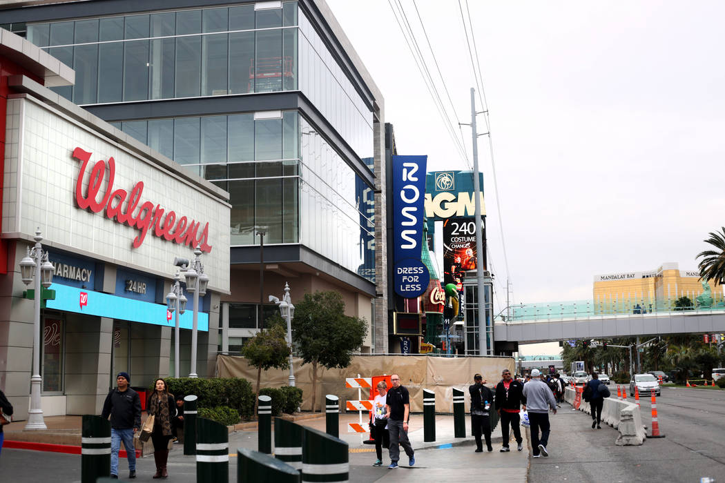 Pedestrians pass the Walgreens on the Strip located at 3765 Las Vegas Blvd. South on Monday, Ja ...