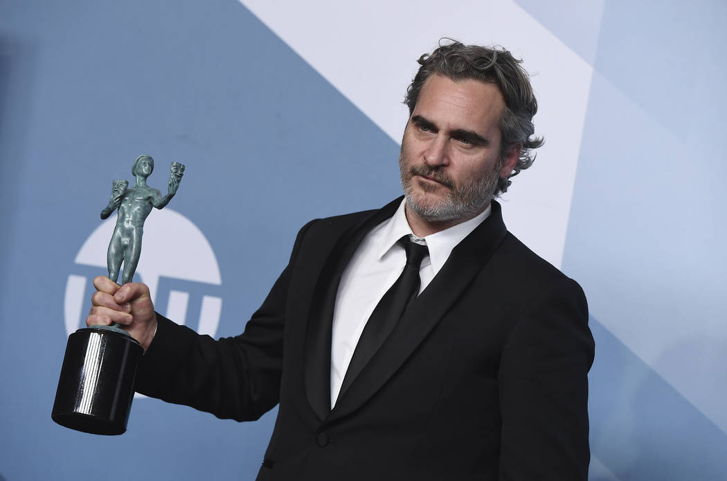 Joaquin Phoenix poses in the press room with the award for outstanding performance by a male ac ...