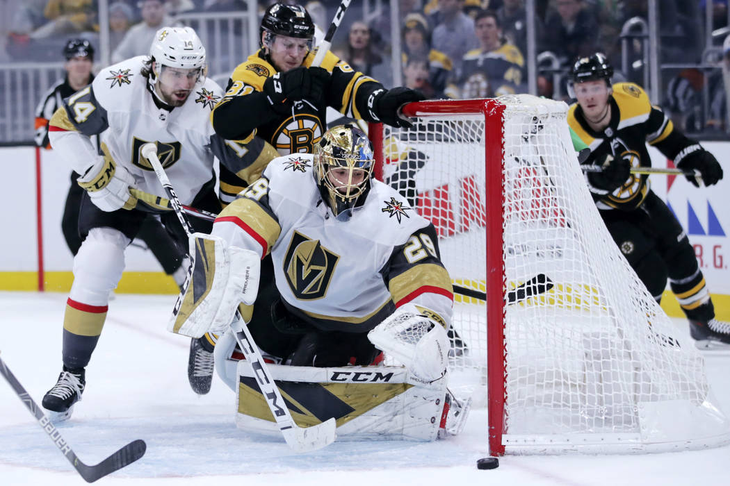 Vegas Golden Knights goaltender Marc-Andre Fleury (29) watches the puck slide near the post as ...