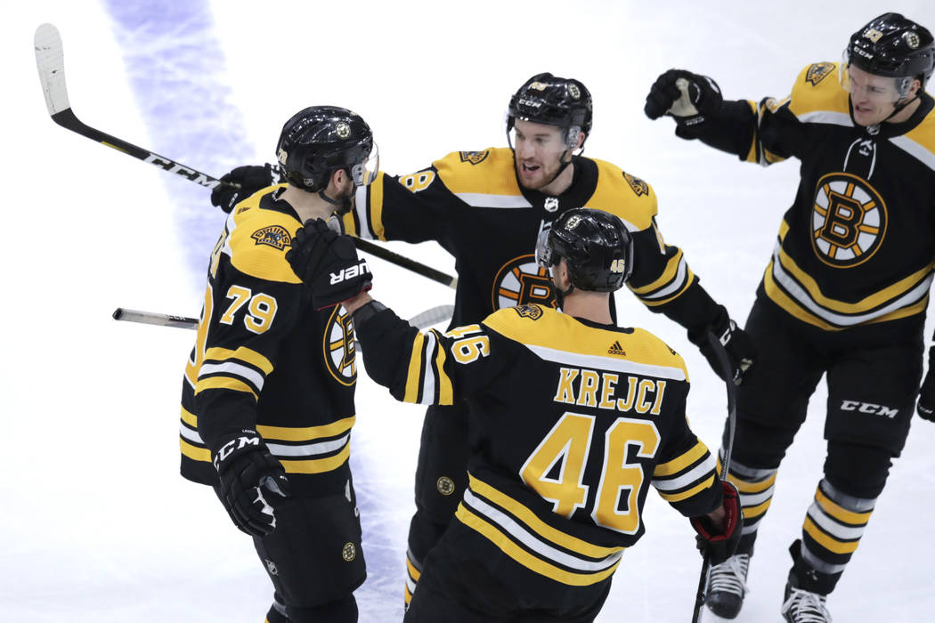 Boston Bruins defenseman Jeremy Lauzon (79) is congratulated by teammates after his goal during ...