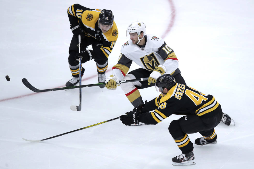 Vegas Golden Knights forward Nicholas Roy (10) threads between Boston Bruins left wing Anders B ...