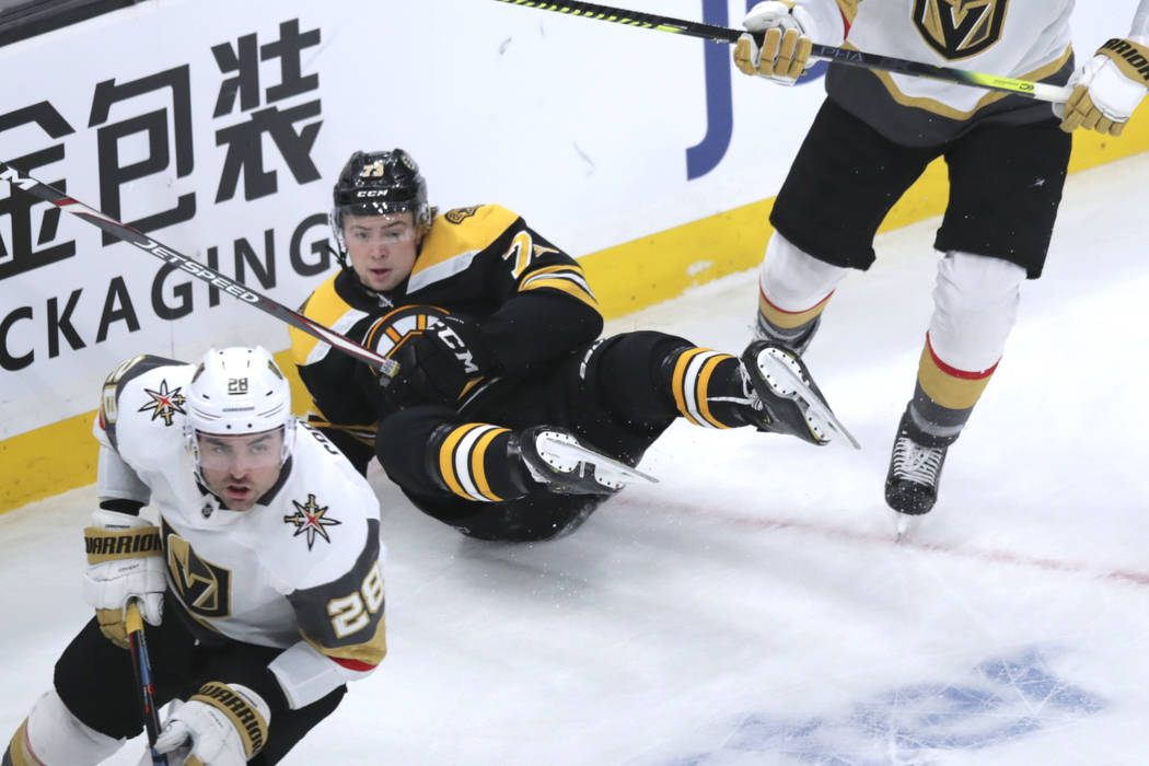 Boston Bruins defenseman Charlie McAvoy (73) hits the ice during the first period of an NHL hoc ...