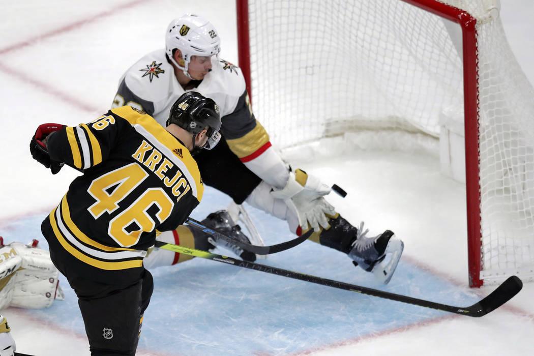 Boston Bruins center David Krejci (46) beats Vegas Golden Knights defenseman Nick Holden (22) f ...