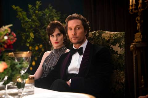 This image released by STXfilms shows Michelle Dockery, left, and Matthew McConaughey in a scen ...
