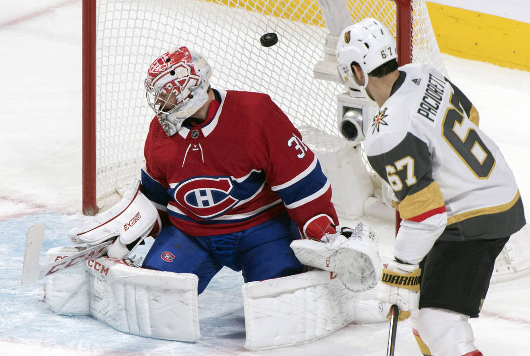 Montreal Canadiens goaltender Carey Price, left, is scored against by Vegas Golden Knights' Rei ...