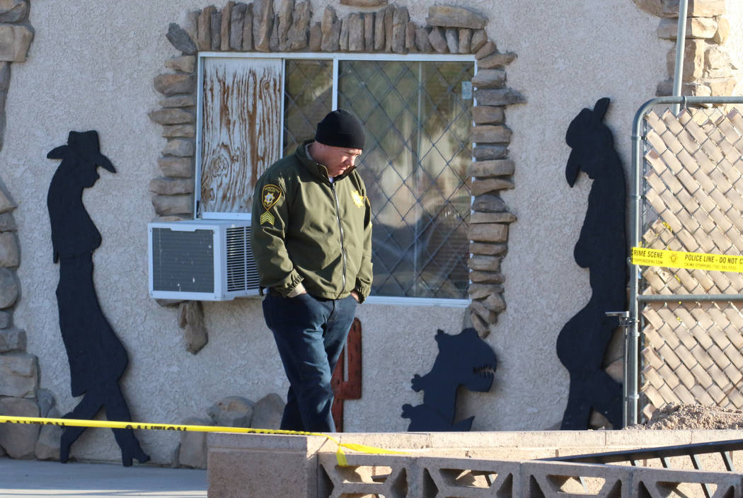 A Las Vegas police officer investigates after a person died in a shed fire at 2350 Lincoln Road ...