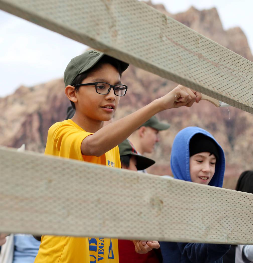 Juan Diego Lara- Hernandez, 12, with Scouts BSA of Las Vegas Troop 219, paints a fence at Sprin ...