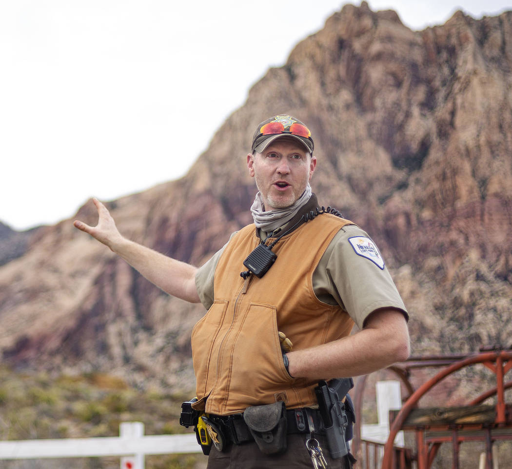 Park ranger David Low gives instructions to volunteers with Scouts BSA during their outreach da ...