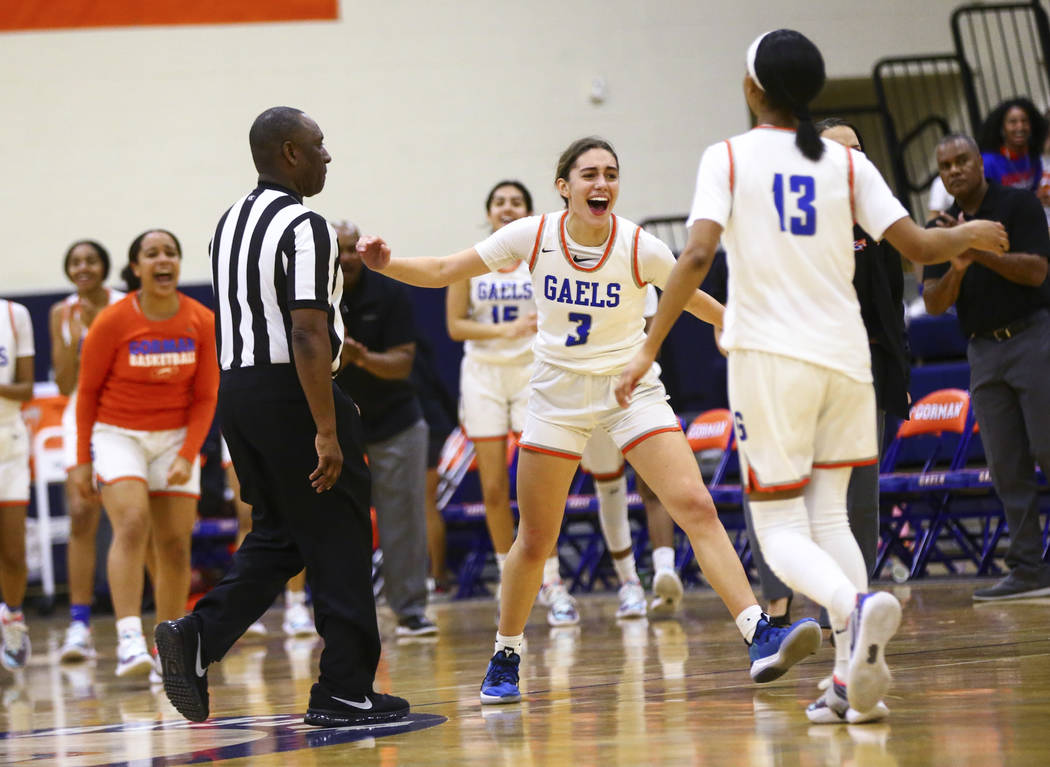 Bishop Gorman's Izzy Westbrook (3) celebrates at the end of the first half of a basketball game ...